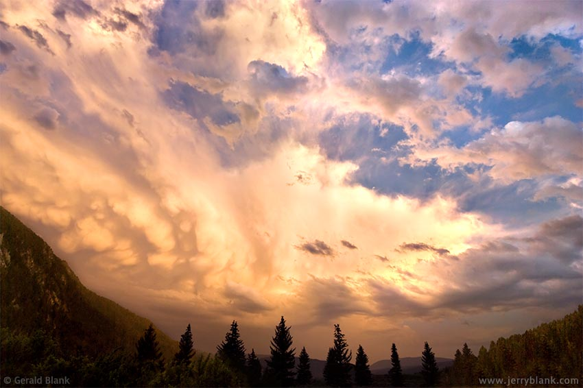 #06085 - Storm clouds dissipate over the Gallatin Canyon, near Soldier's Chapel, Big Sky, Montana - photo by Jerry Blank